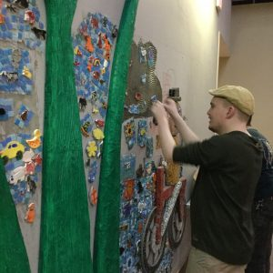 Students at Morris-Union Jointure Commission put the finishing touches on their garden mosaic mural.