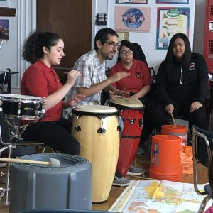Students at The Haledon School practice with musician Hector Morales.