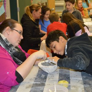 Students teach community members how to create giving bowls at Bradley Beach Elementary School.