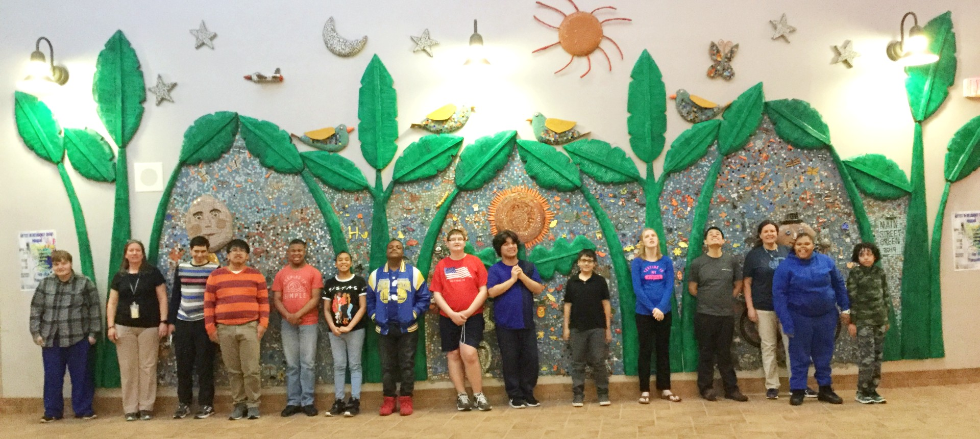 Students from Morris-Union Jointure Commission pose in front of a two-year mural project.