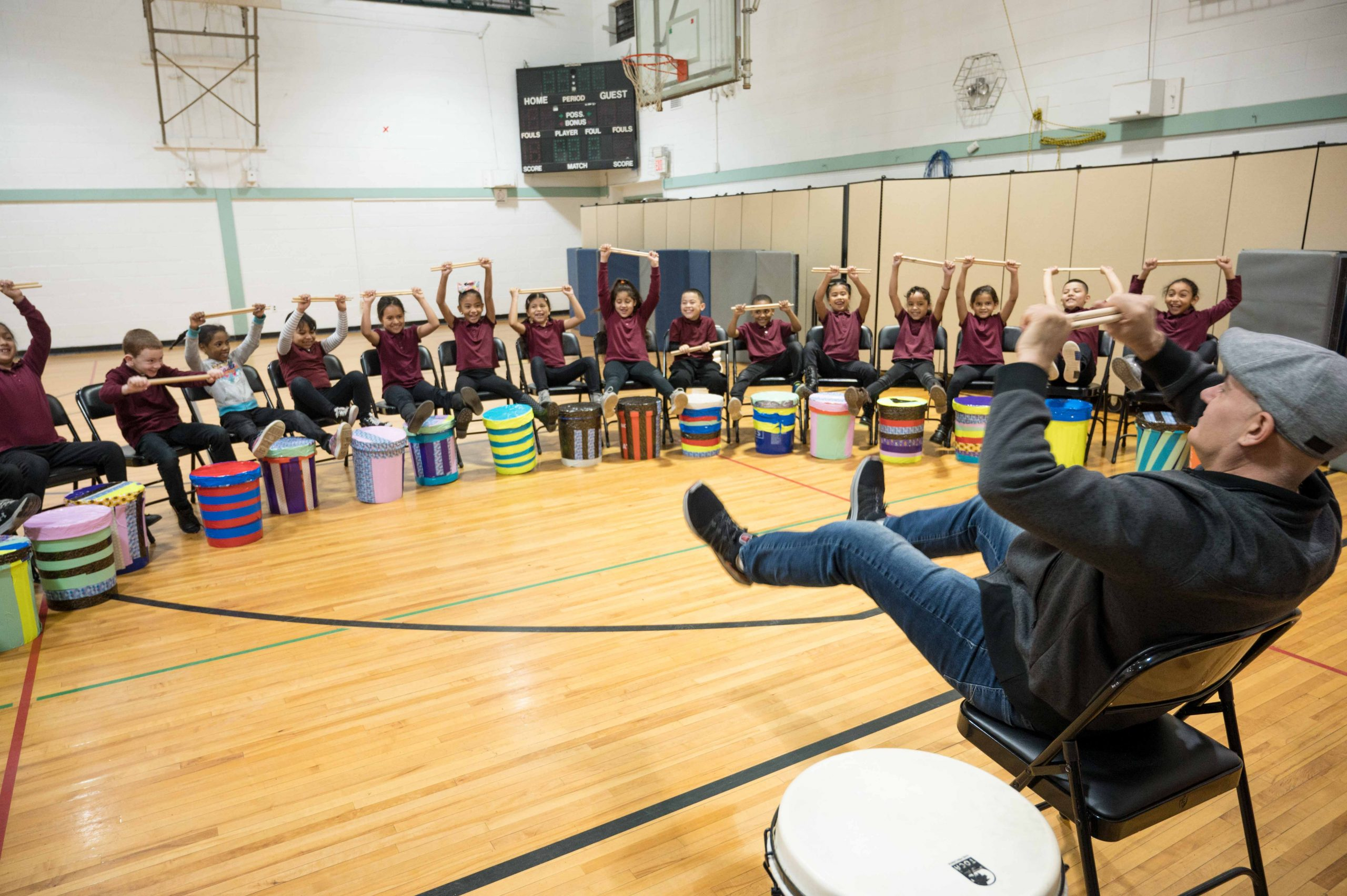 Students at Washington Avenue Elementary school playfully warm up with teaching artist and percussionist Josh Robinson.