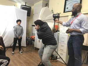 Teaching artist Erik James Montgomery creates a mobile photography studio with students from Bradley Beach Elementary School.