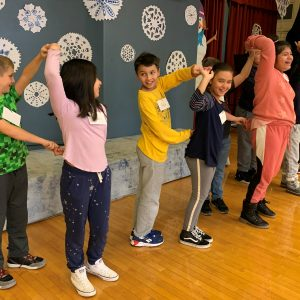 Students at Bradley Beach Elementary School practice bachata with their dance partners.